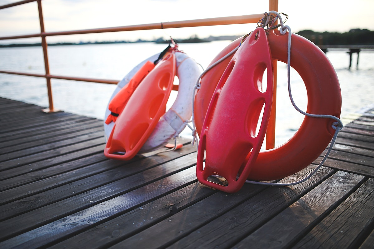 Lifebuoy on a pier. Visit Kaboompics for more free images.
