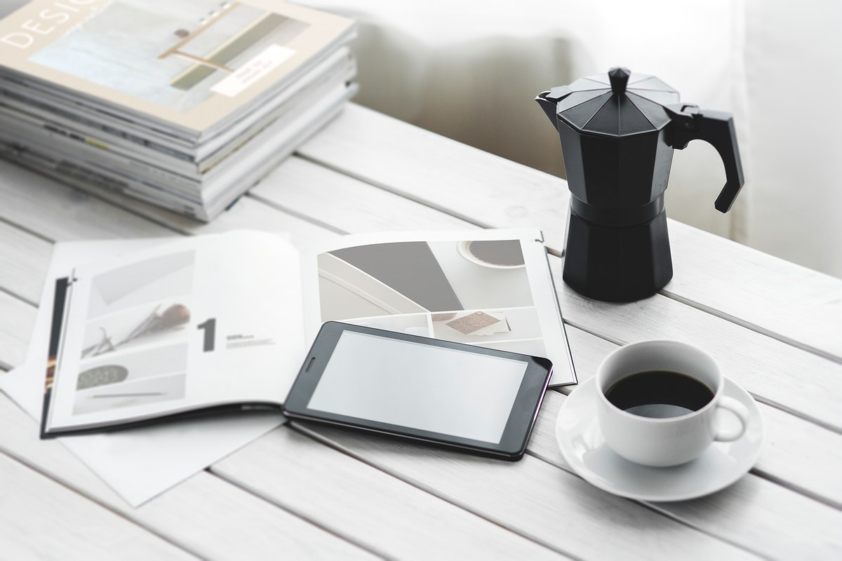 Coffee and a magazine. Visit Kaboompics for more free images.
