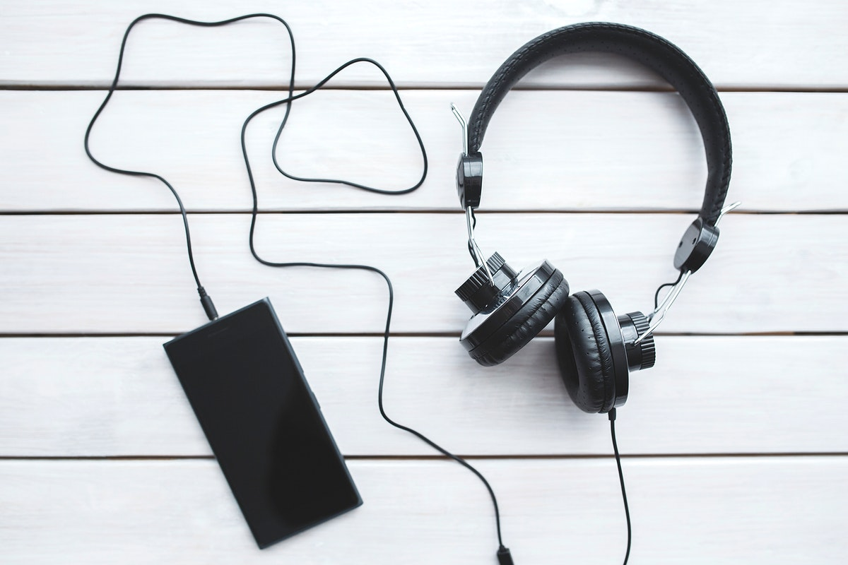 Smartphone with black headphones. Visit Kaboompics for more free images.