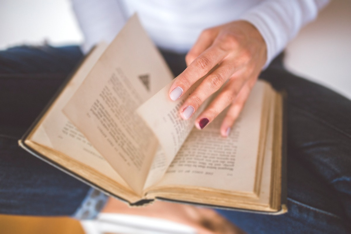 Woman reading a book. Visit Kaboompics for more free images.