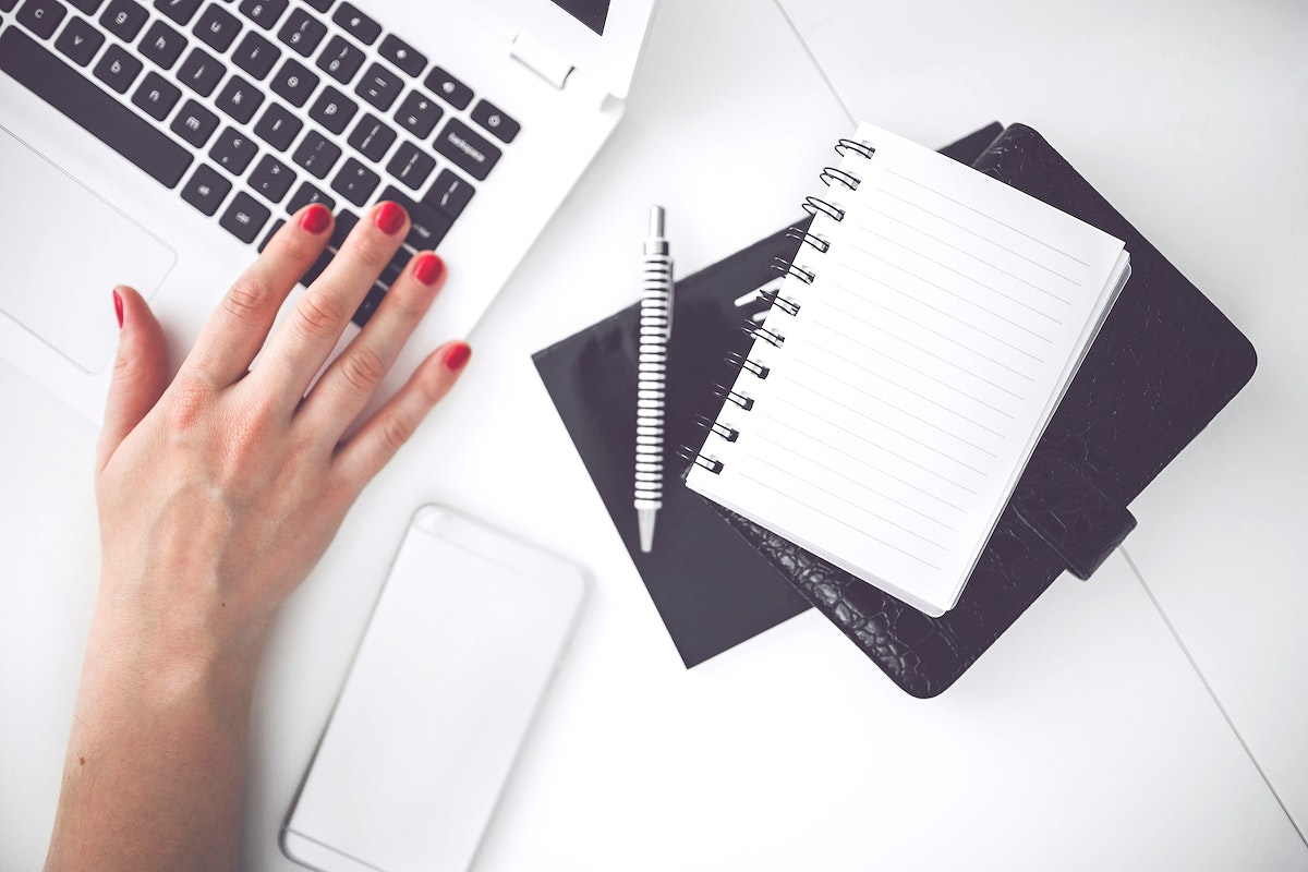 Woman using a laptop. Visit Kaboompics for more free images.