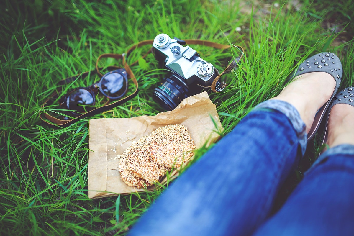 Photographer sitting in the grass. Visit Kaboompics for more free images.
