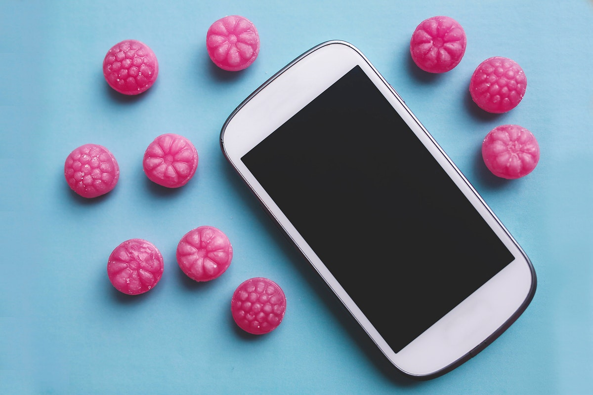 Phone and pink candies. Visit Kaboompics for more free images.