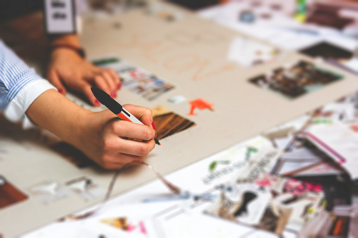 People working on creative projects. Visit Kaboompics for more free images.