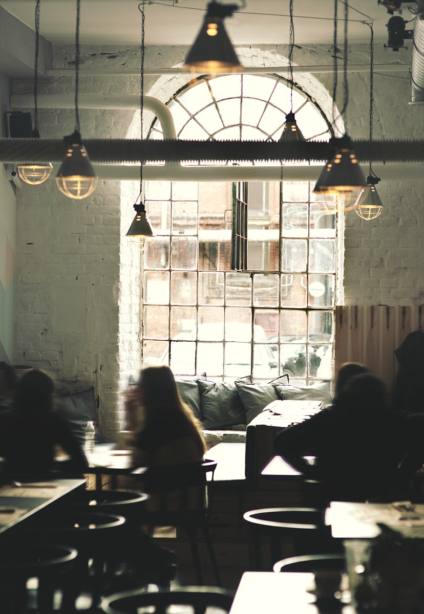 People sitting in a coffee shop. Visit Kaboompics for more free images.