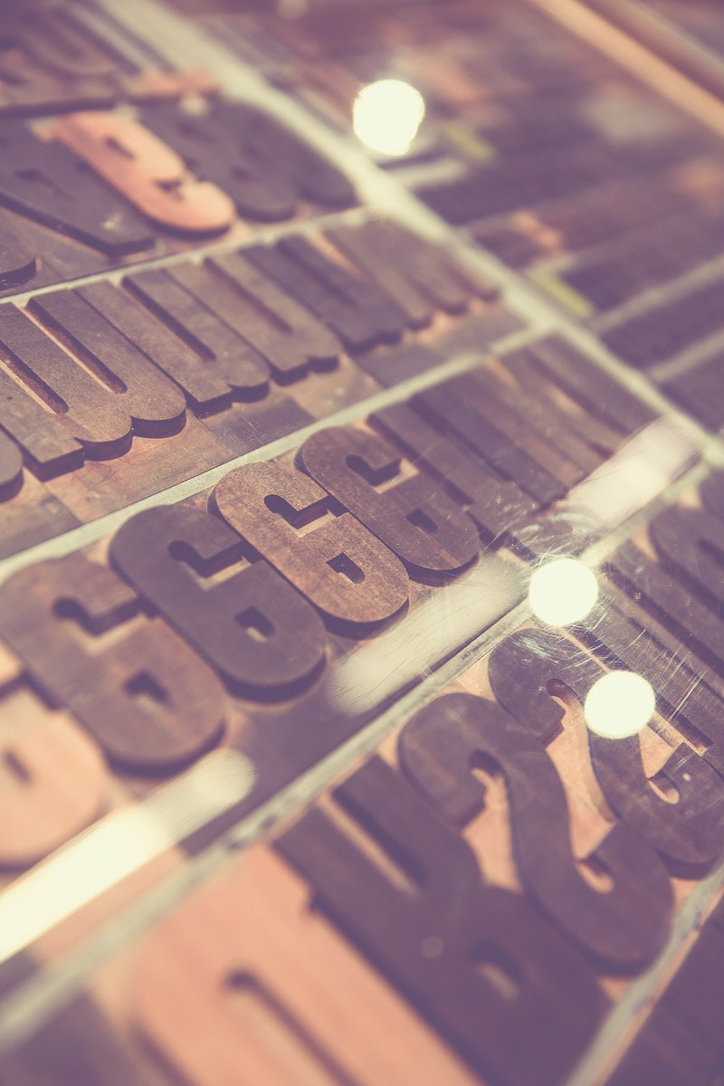 Rows of rusty steel typographic letters