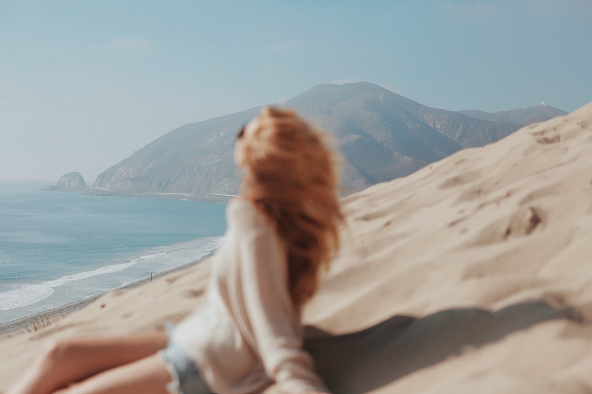 Blonde woman on a sand dune