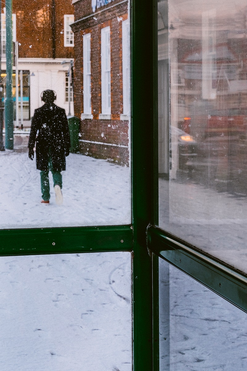 Man walking through the snow