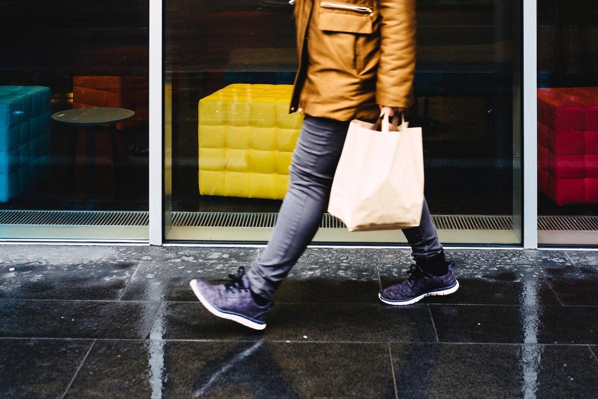 Man walking down a wet street