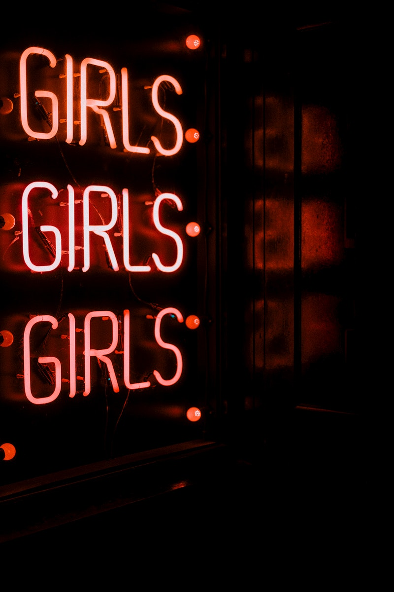 Girls, red neon sign