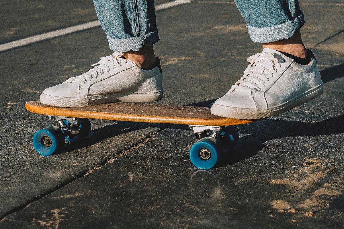 Man on a small skateboard