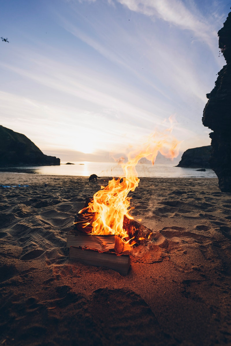 Summer bonfire by the beach in Wales