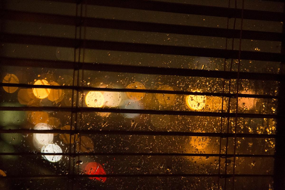 Bokeh yellow lights outside the window