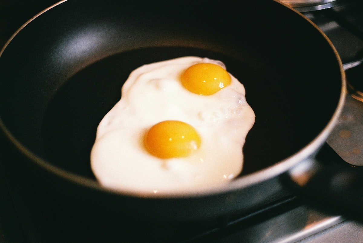 Double egg frying in a pan