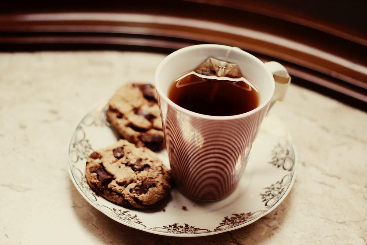 Hot cup of tea and cookies