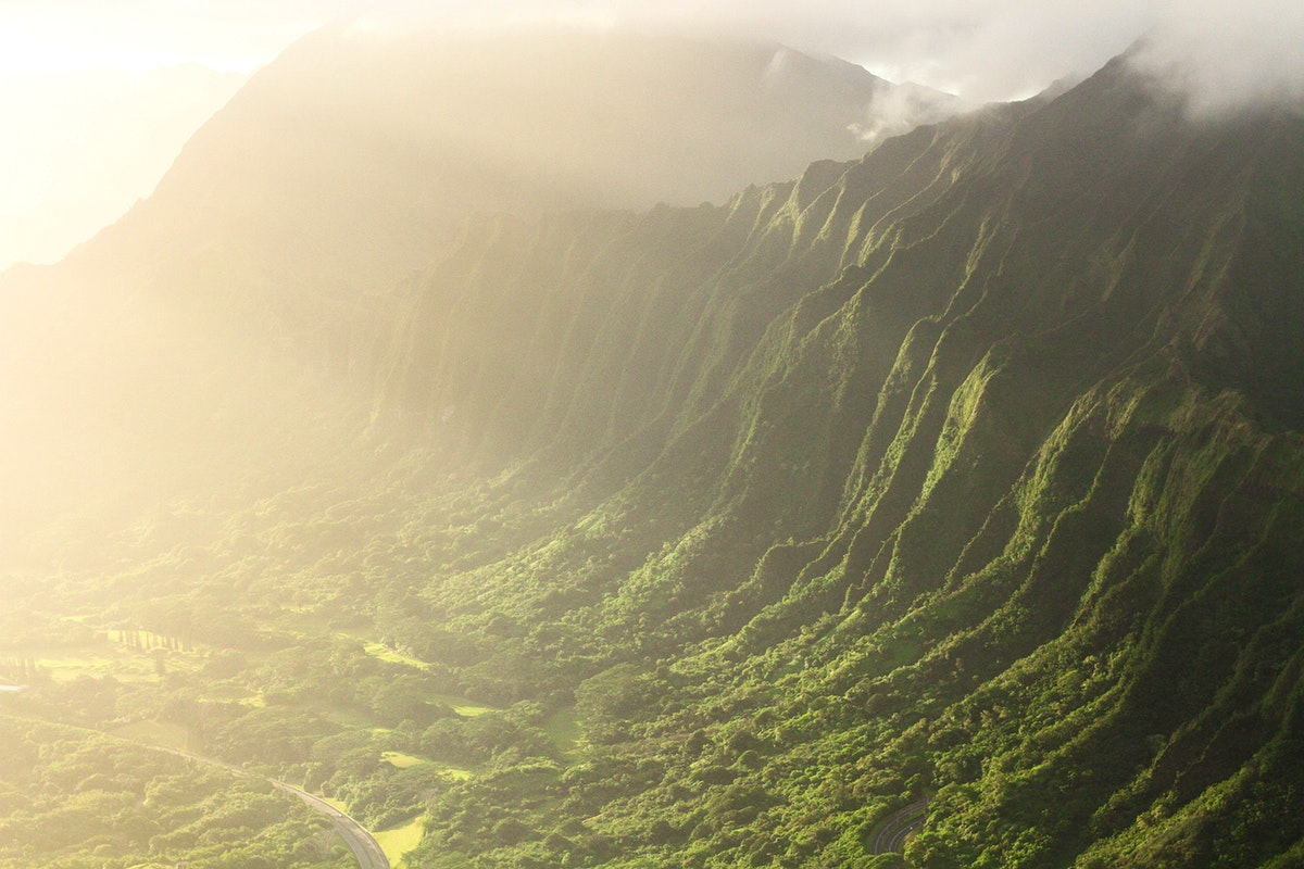 View of sunlight against a mountain in Oahu, Hawaii