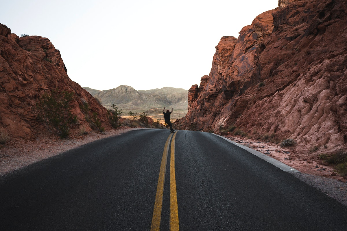 Man skating on the road in Valley of Fire State Park, Overton, United States
