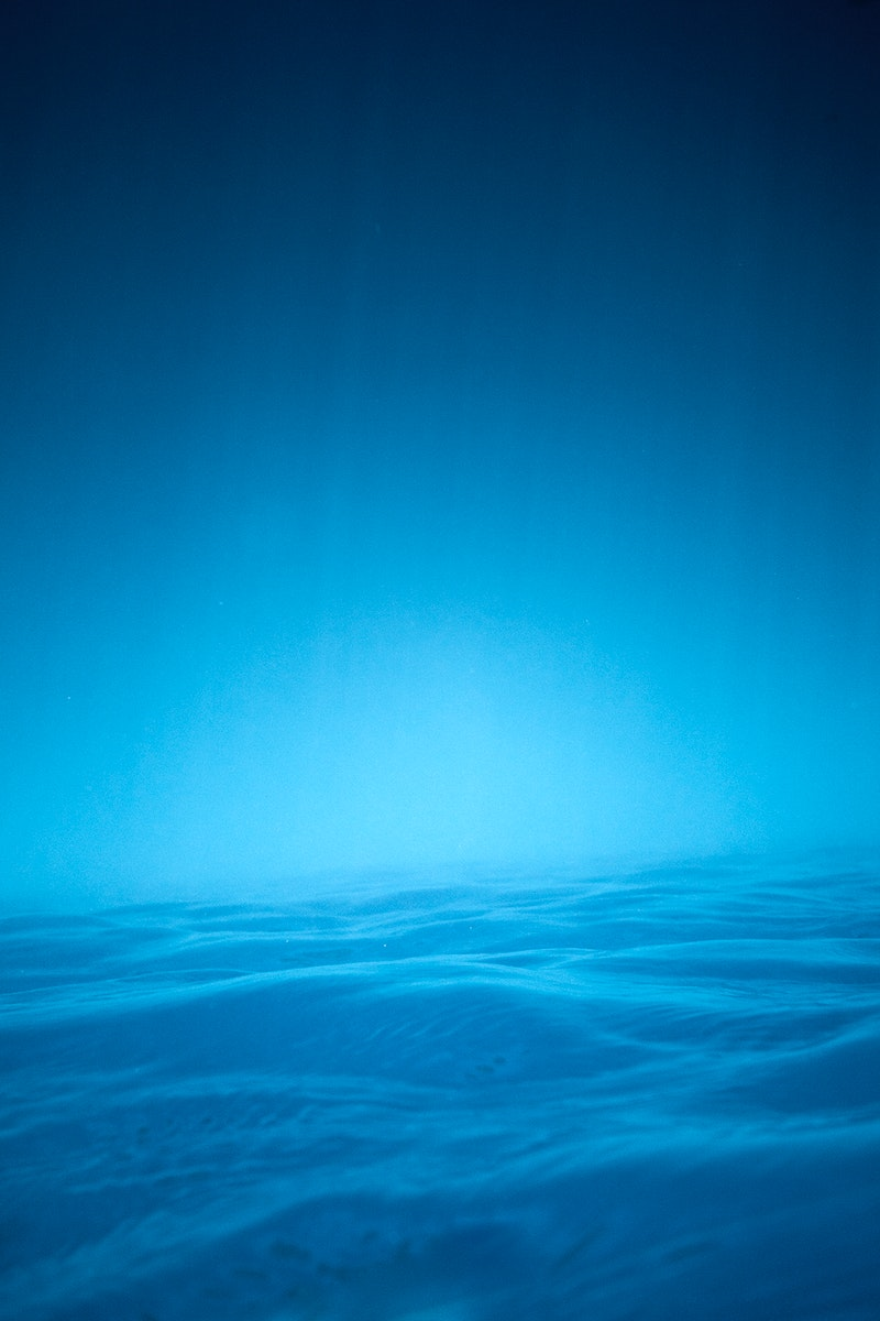 Blue ocean in the evening with mild waves