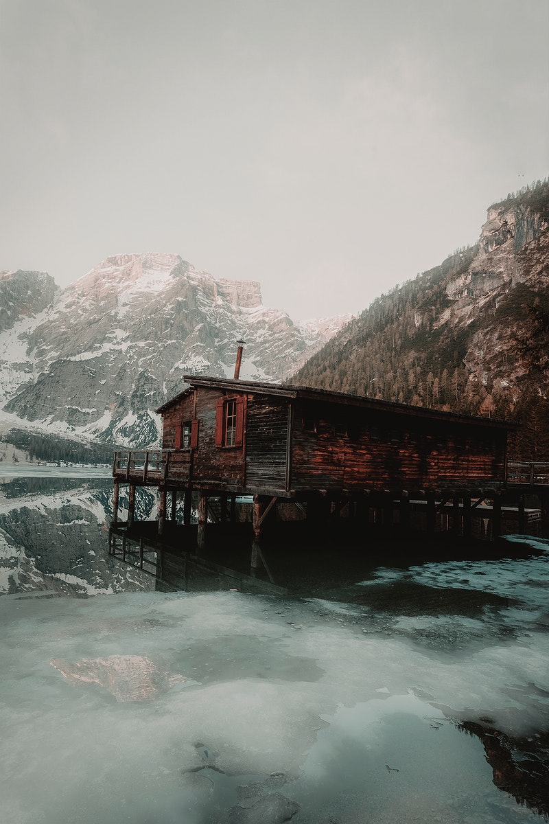A chalet by Braies lake, Dolomites, South Tyrol, when the sun slowly lifts the mist off