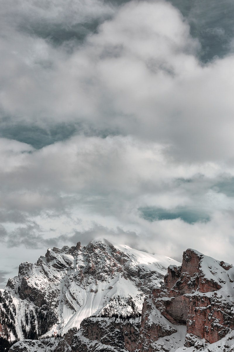 The snow atop the foggy summit of the Dolomites