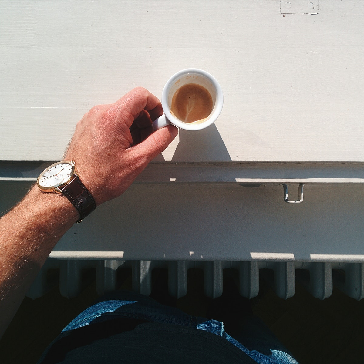 Man holding a cup of espresso