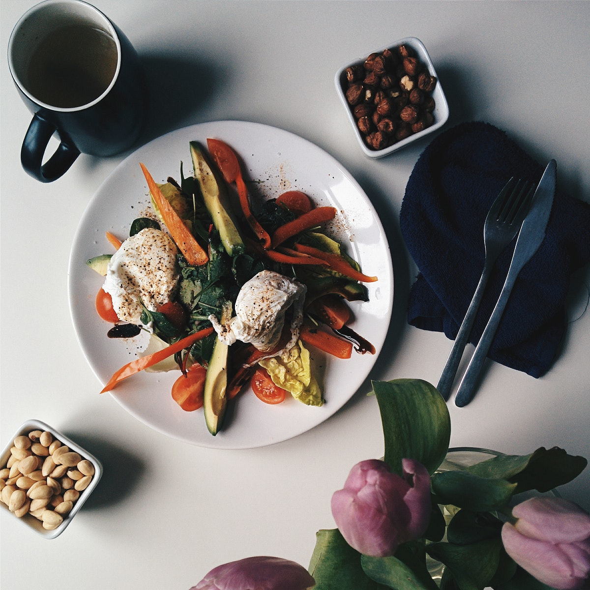 Paleo breakfast with vegetables, avocado and nuts