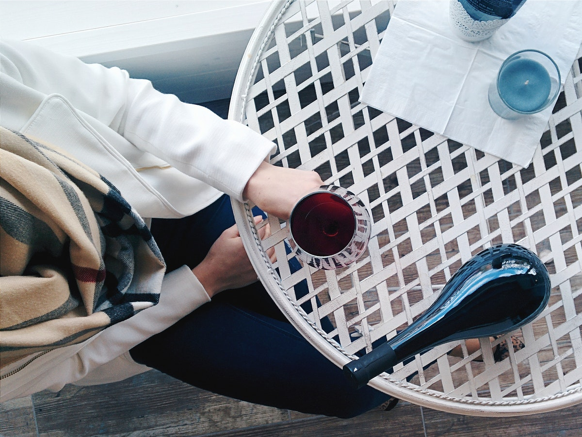 Woman having glass of red wine