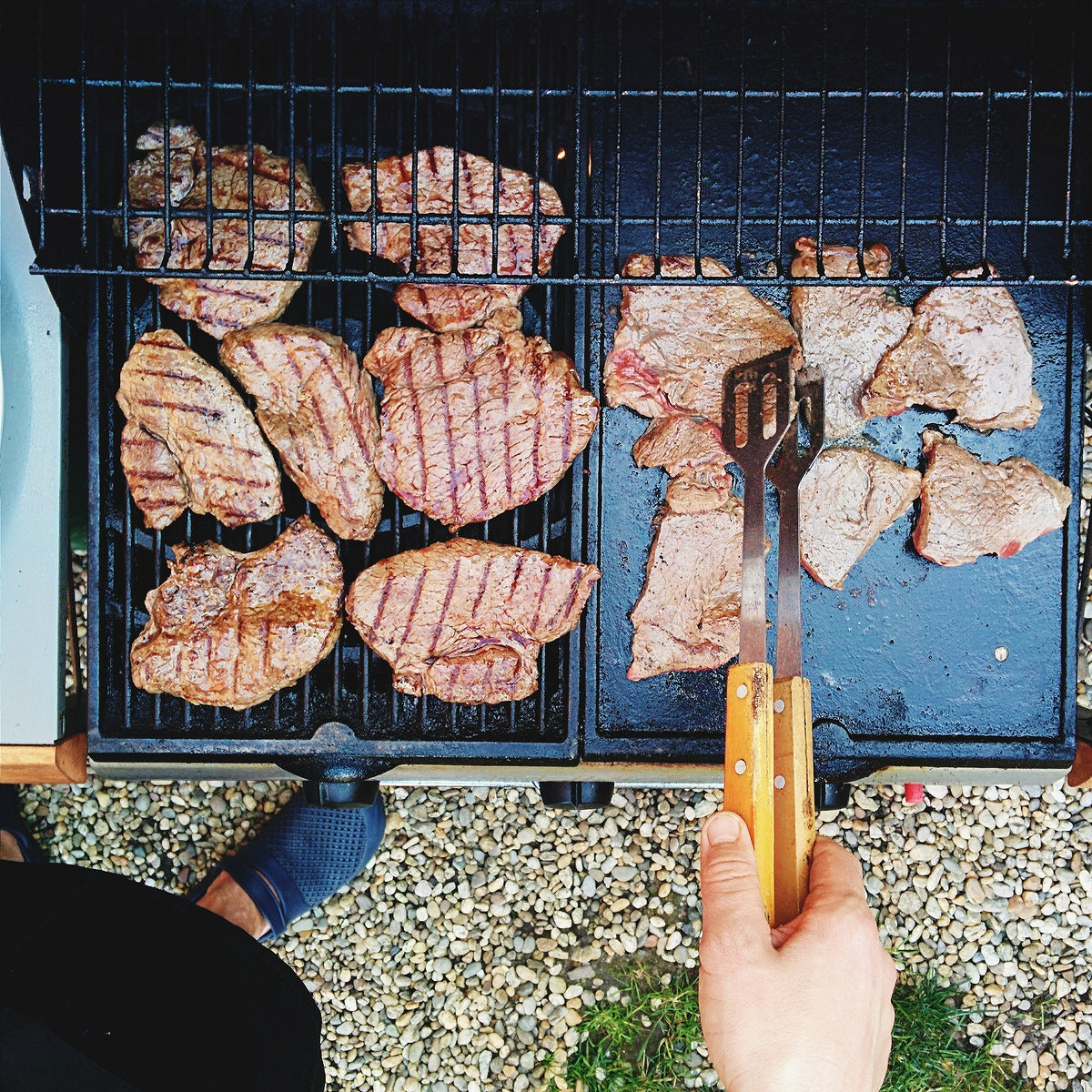 A pork steaks barbeque on a grill