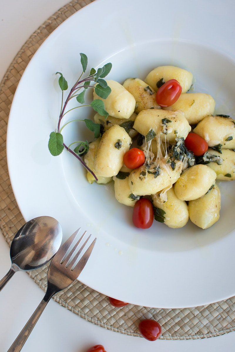 Gnocchi with sage and tomatoes food photography