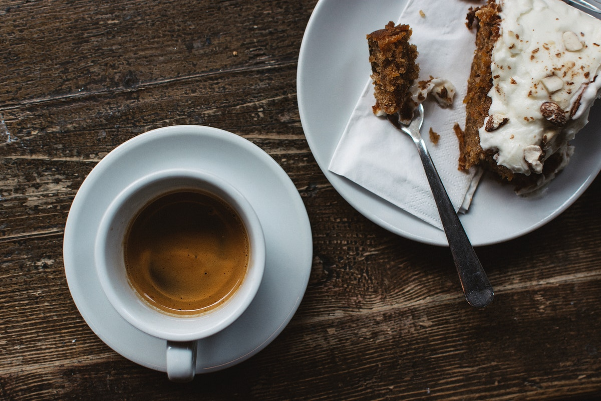 Aerial view of a coffee cup and a piece of cake food photography