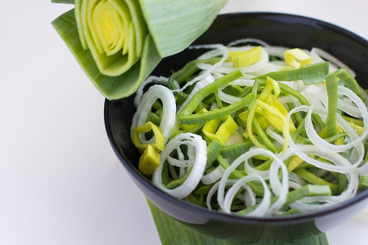 Cut fresh leek in a bowl