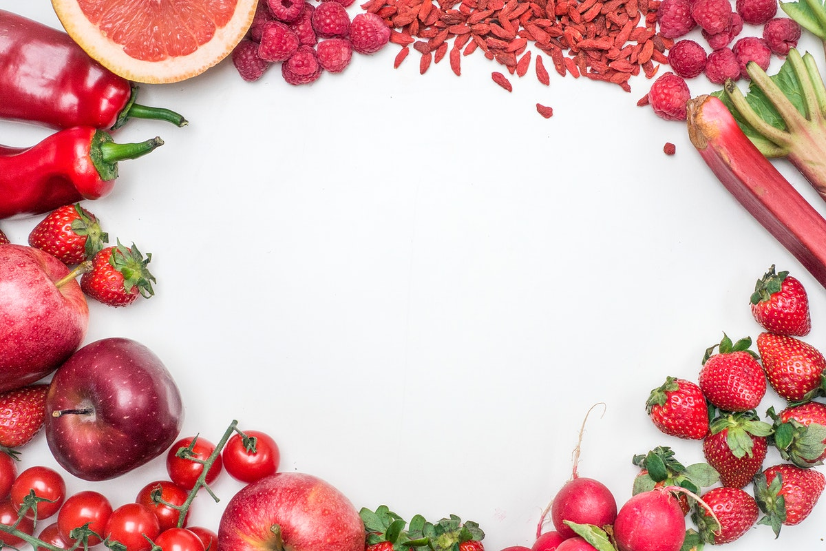 A variety of red fruits and vegetables