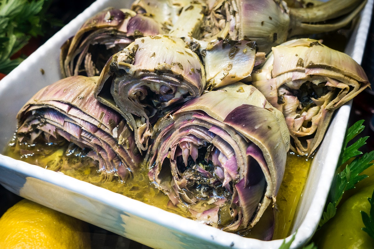 Cooked artichokes in a stainless container