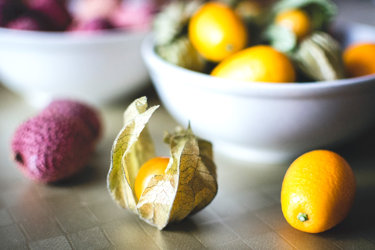 Cape gooseberries, kumquats and lychees in the bowls