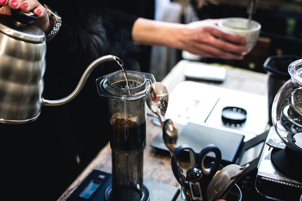 Demonstrating how to make pour over coffee