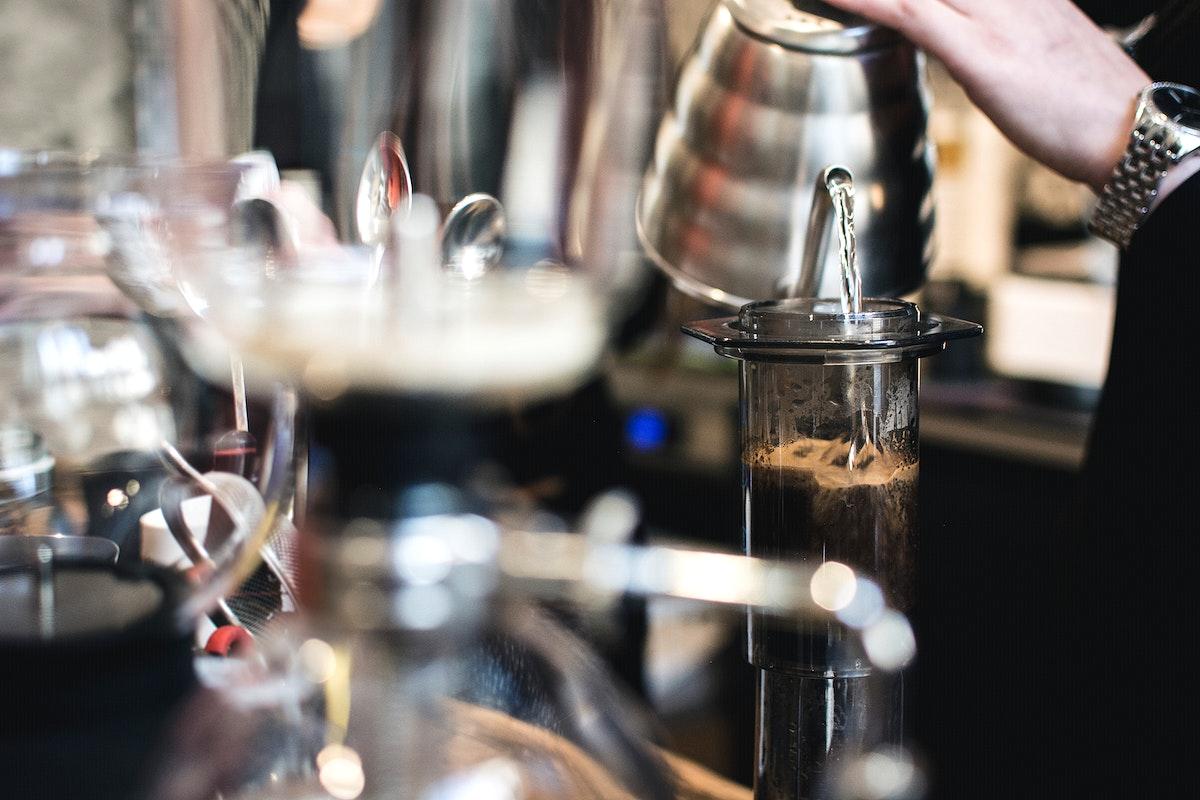Barista making coffee using an aeropress