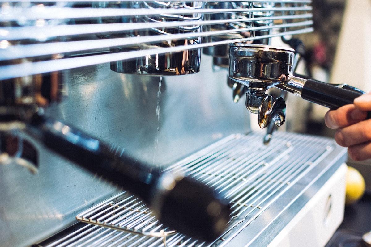 Barista operating a coffee machine