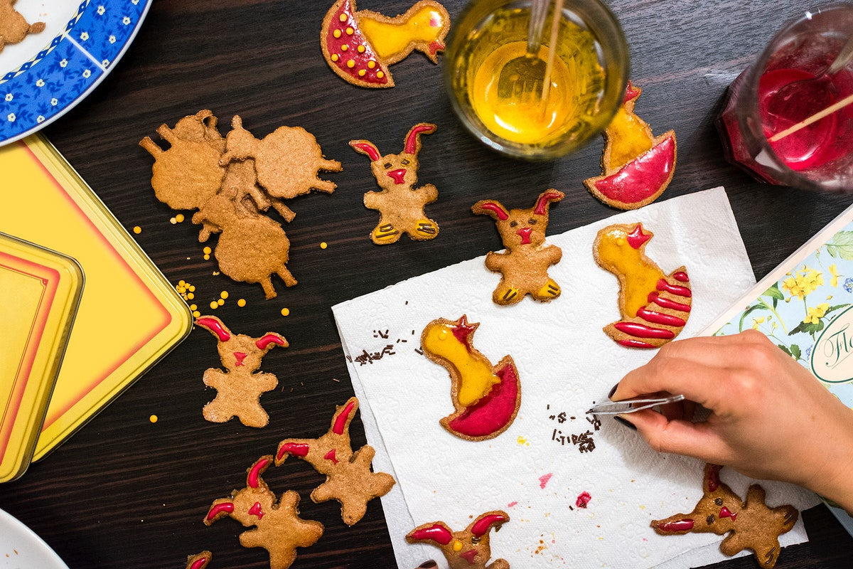 Woman decorating Easter gingerbread food photography