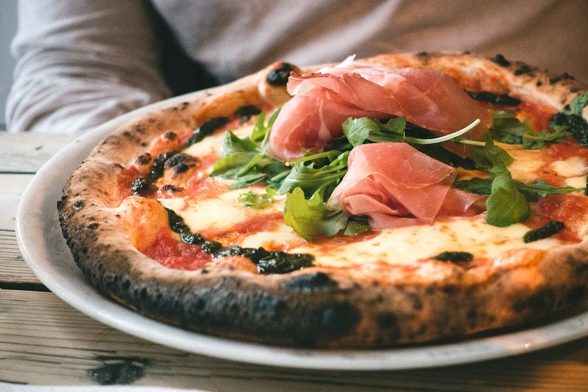 Homemade pizza with prosciutto crudo food photography