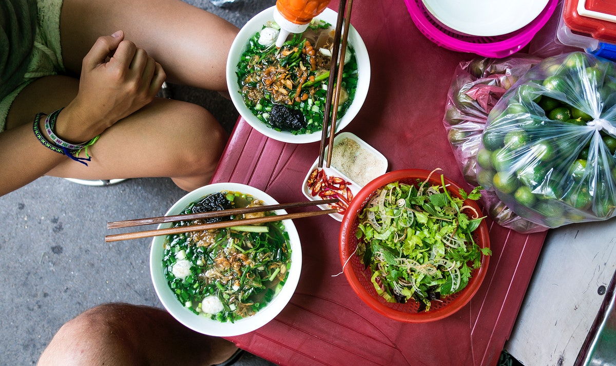 Eating Pho, a Vietnamese noodle soup