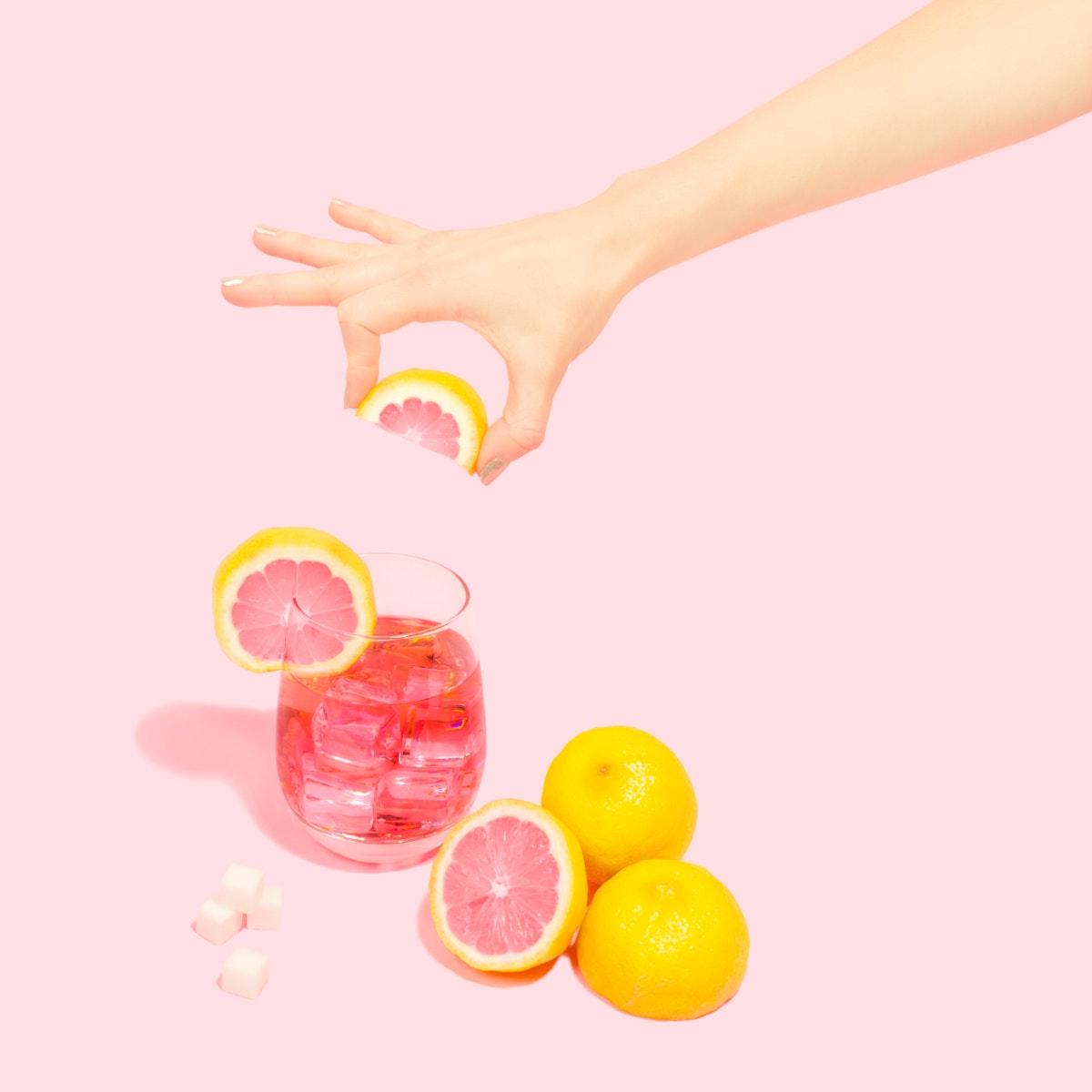 Woman squeezing fresh variegated eureka juice