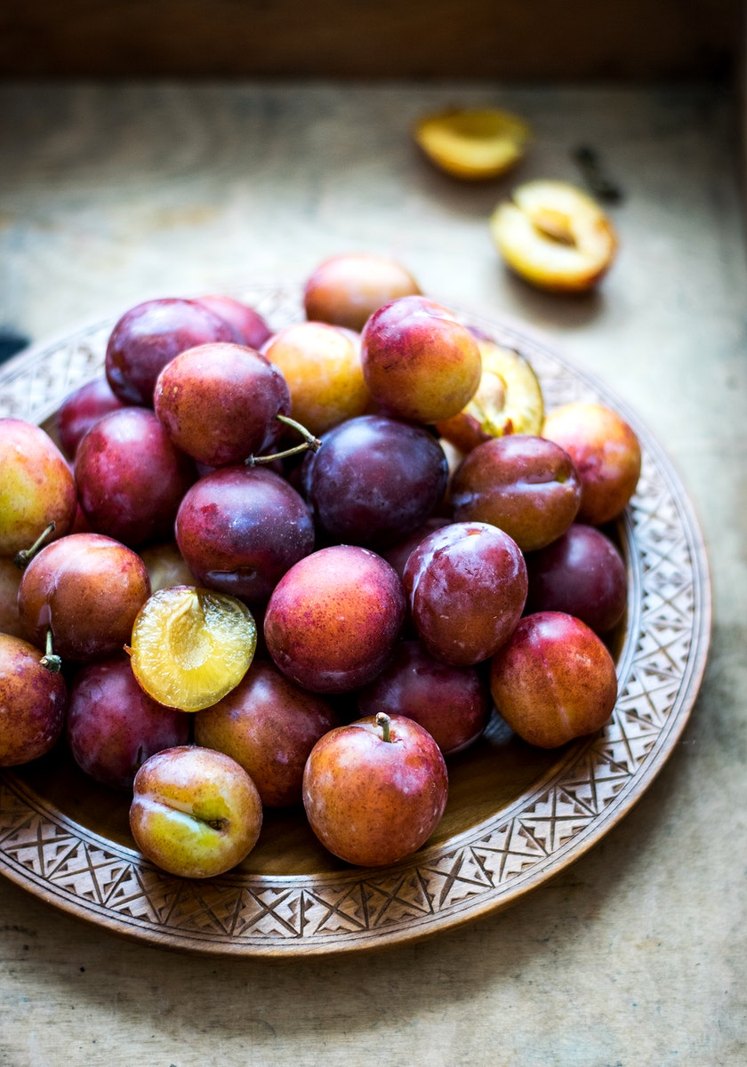Food photography of fresh plums. Visit Monika Grabkowska to see more of her food photography.