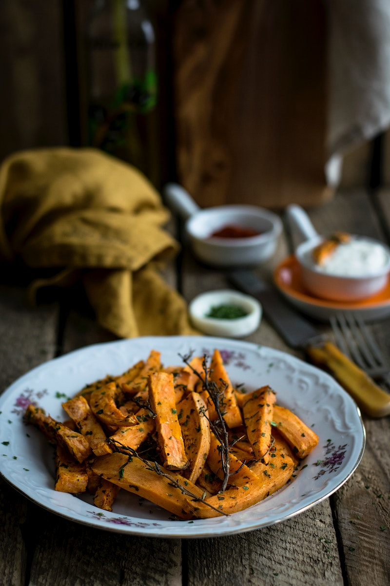 Sweet potato baked with herbs. Visit Monika Grabkowska to see more of her food photography.