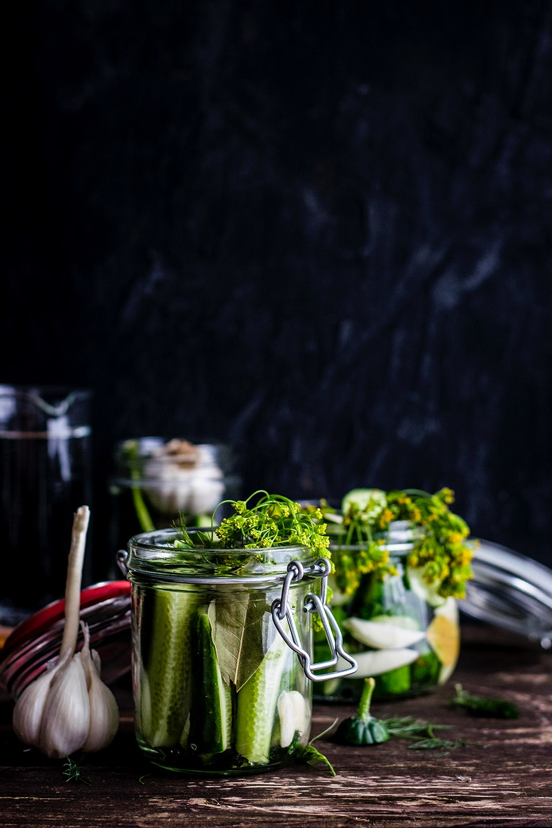 Homemade pickled cucumbers in a jar. Visit Monika Grabkowska to see more of her food photography.