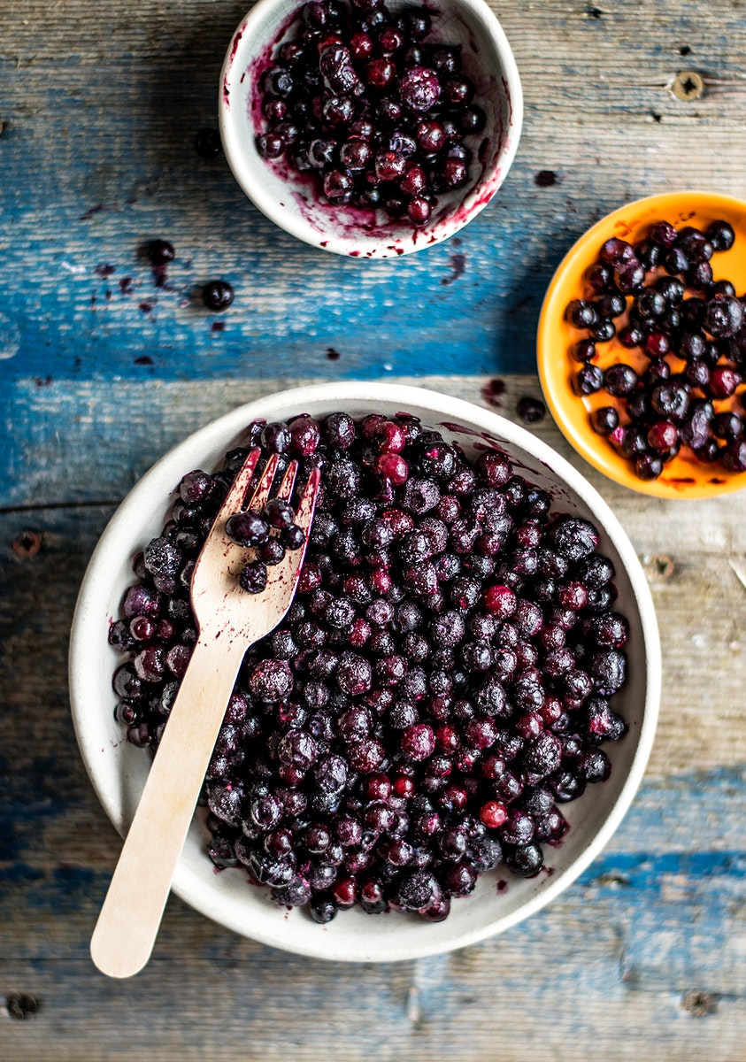 Frozen wild berries in a bowl. Visit Monika Grabkowska to see more of her food photography.