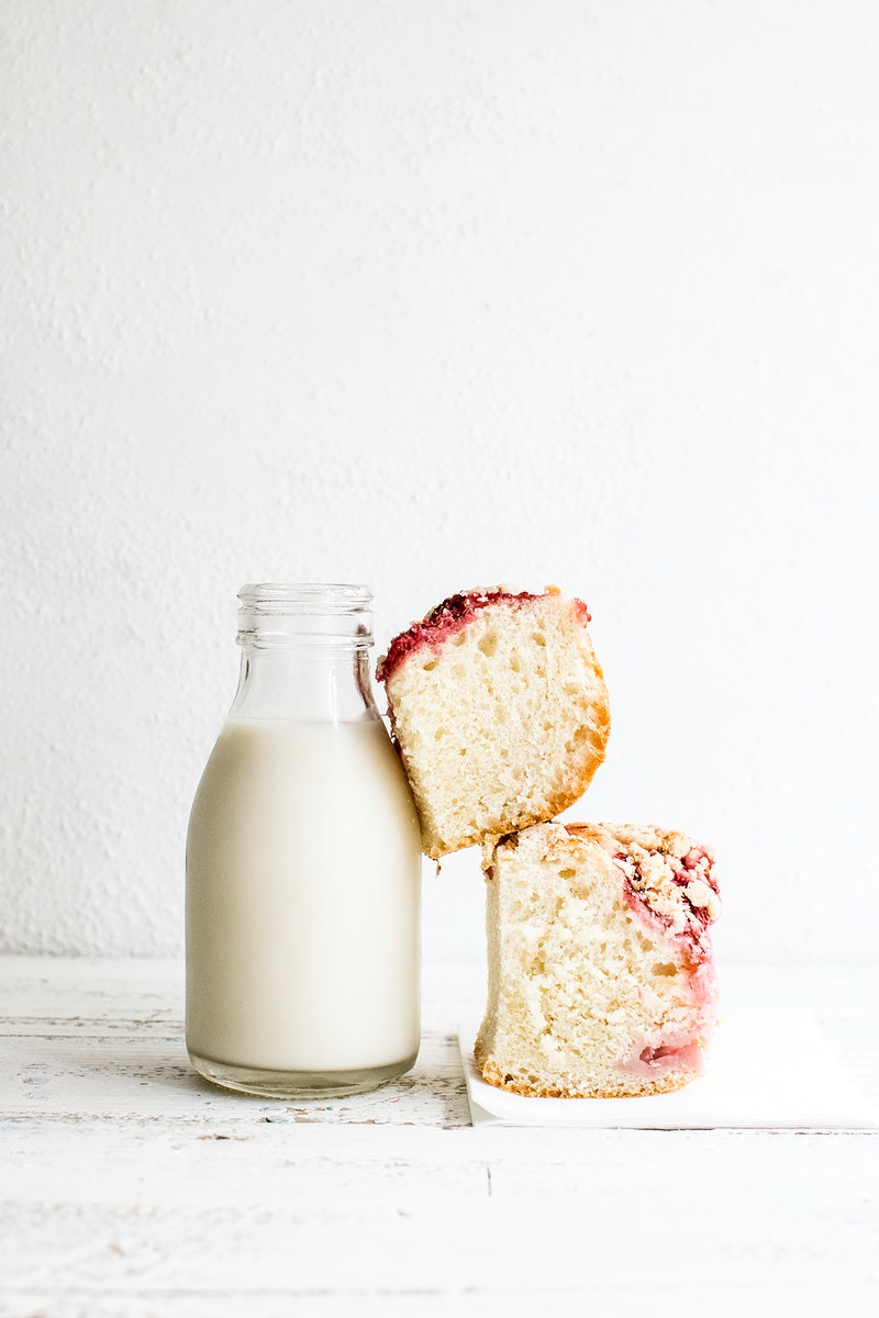 Bottle of milk and yeast cake topped with strawberries. Visit Monika Grabkowska to see more of her food photography.