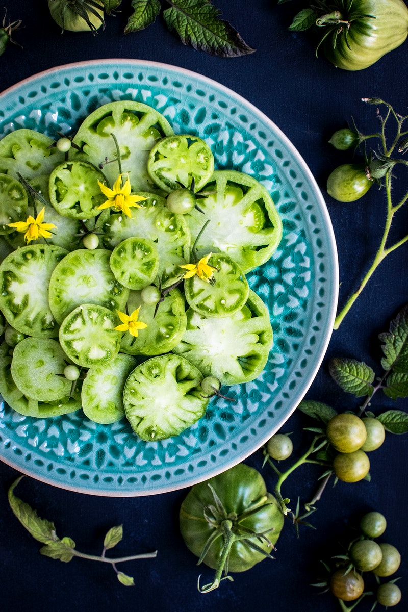 Plate of fresh green tomato salad. Visit Monika Grabkowska to see more of her food photography.