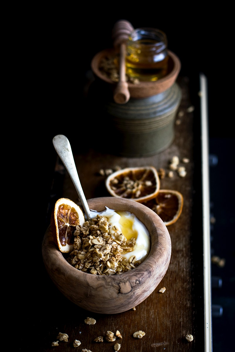 Greek yoghurt with coconut granola. Visit Monika Grabkowska to see more of her food photography.
