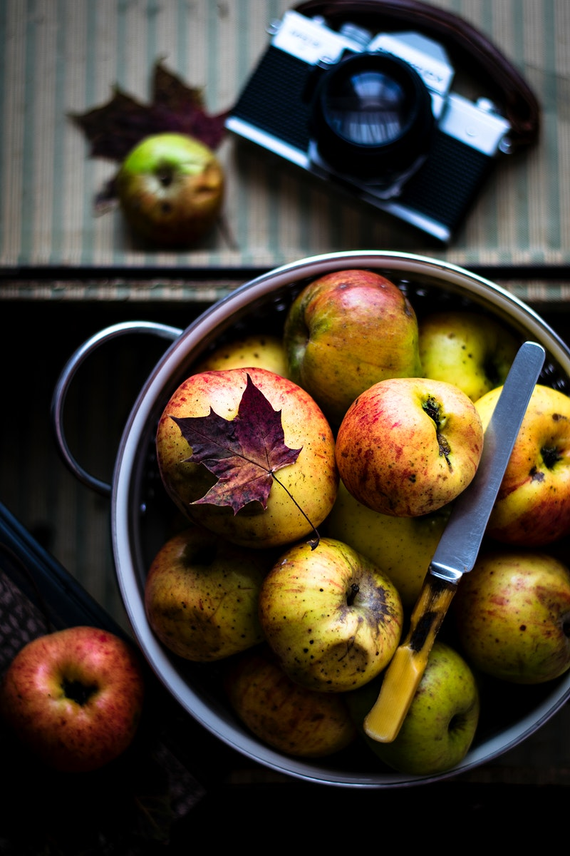 Fresh organic autumn apples in a bowl. Visit Monika Grabkowska to see more of her food photography.