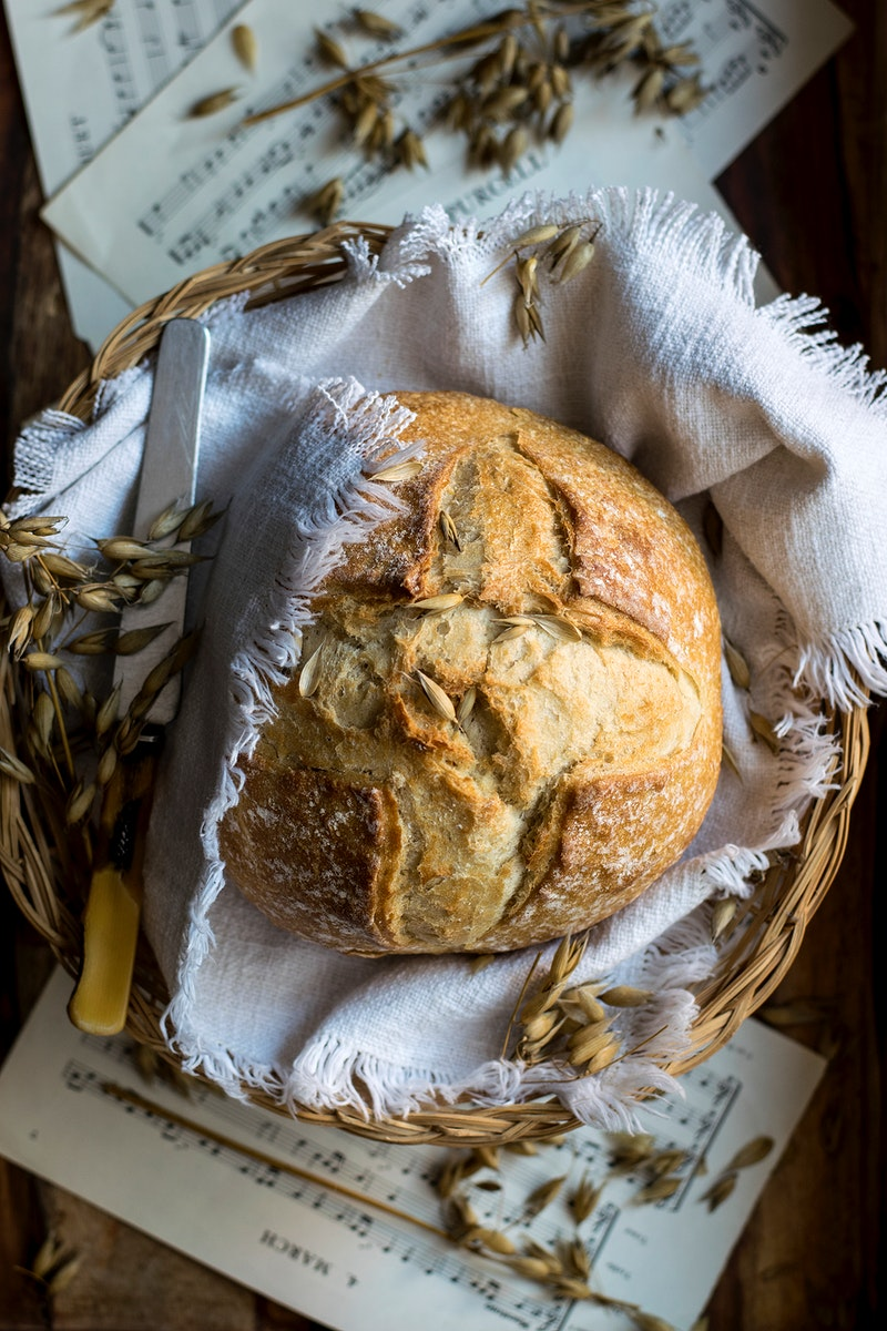 Homemade round bread with oats. Visit Monika Grabkowska to see more of her food photography.